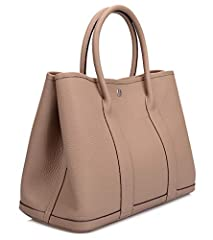 Full grain cow leather Fabric lining Top handle only, can not wear on the shoulder One zippered pocket in the interior 14.2'' bottom long, 5.5'' wide, 10.2'' high