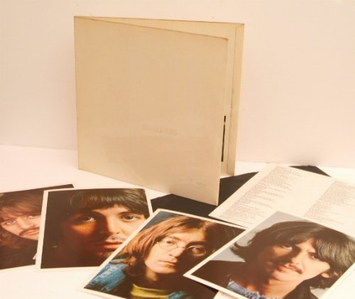 THE BEATLES white album. Top copy. UK Pressing 1968. Mono. Rare low numbered top opening black inners, complete with poster and four photos.