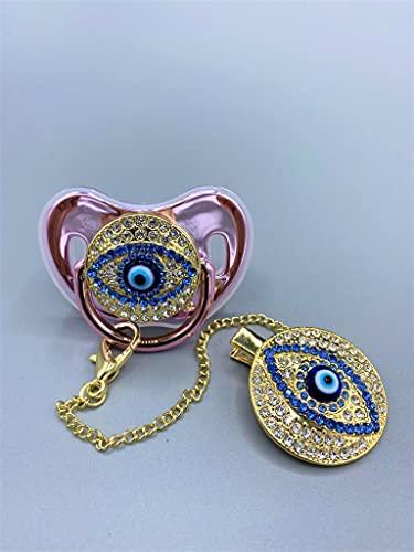 Chupete Jewel en silicona NUK anatómica, hipoalergénica y anticólicos, rosa vertical, anilla de oro pulido con ojo de Fátima