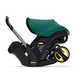 COLOR: All Black Patterned Textile Fabric, New Stretch Material Canopy in Racing Green, New Stretch Material Shoulder Pads in Racing Green, New and Improved Breathable Inner Foams, Charcoal Aluminum Handle, Dark Grey Bamboo Infant Insert, Dark Gray B...