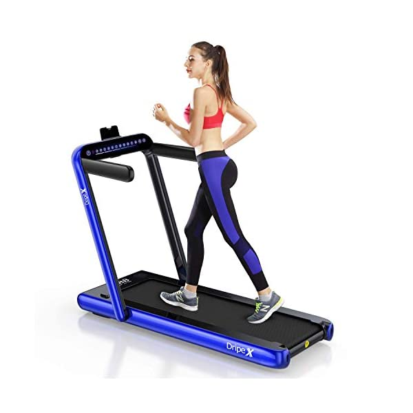 Woman running on a dripex 2 in 1 treadmill with blue jogging bottoms and red tank top