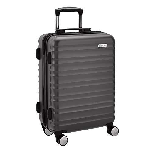 AmazonBasics - Trolley rigido di prima qualità con ruote multidirezionali, con lucchetto TSA integrato, approvato dalla maggior parte delle compagnie aeree low cost, 55 cm, nero