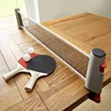 Instant Extendable Full Size Table Tennis Game Set With Net Bats & Balls  Take the net posts and pull them apart to extend the net between them.