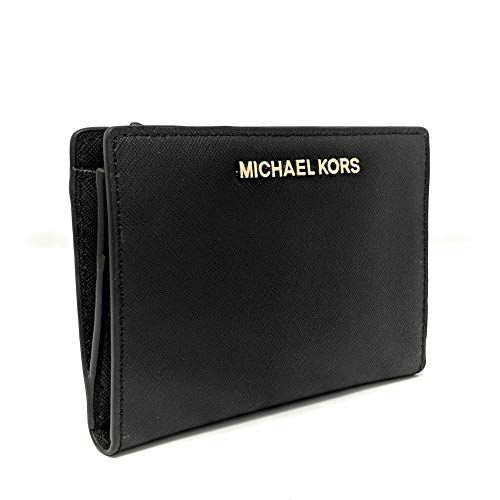 MK Womens Safianno Leather, Silver Hardware and Zip Coin Pocket. Approximate Measures 5.75 in x 4 in x 1 in. Removable Card Holder Has 3 Card Slots Plus ID Window. Wallet Has Another 3 bigger Pockets and 3 Card Slots Inside, One Exterior Pocket In Th...