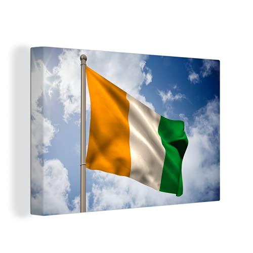 Leinwandbild - Fliegende Flagge der Elfenbeinküste - 150x100 cm
