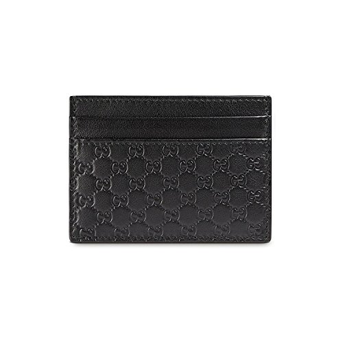 Black leather card case wallet with Guccissima pattern, four pockets for credit card and one central additional pocket, measures: 3,93 x 2,75 inch. Brand new and delivered with manufacturer warranty and genuine GUCCI presentation box.