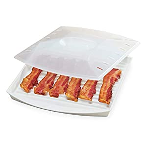 "BACON GRILL: This Bacon Grill with Cover cooks 4-6 strips of bacon to perfection in the microwave. Its special design keeps bacon elevated so fat drips off, leaving you with a healthier breakfast side. Minimum turntable diameter 12.5"". INNOVATIVE DES..."