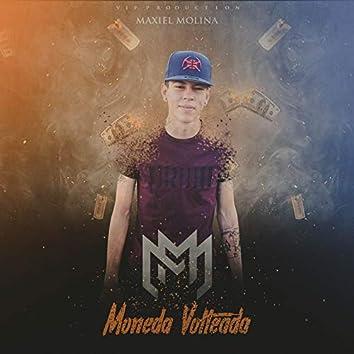 Moneda Volteada