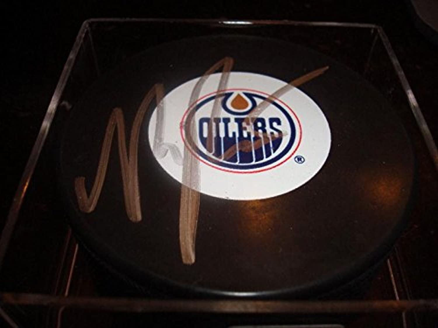 Magnus Paajarvi Signed Hockey Puck  Autographed NHL Pucks