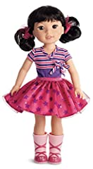 """Emerson loves the spotlight-and the spotlight loves her right back She loves to make her friends smile with funny jokes, original dance routines, and show-stopping songs This 14.5"""" (36.8 cm) doll is sized just right for younger girls She has dark-bro..."""