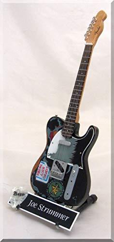 Joe Strommer - Guitarra en miniatura con púa de guitarra