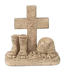 Soldier's Boots and Helmet At Cross Stone Memorial Statue