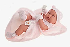 Antonio Juan, Nina doll. The doll is dressed in a pink knitted romper with hood and matching socks.It has a soother and a blanket with it. 100% superior quality cotton. The tiny mouth and fine wrinkles. Each small detail is perfect and realistic.Anat...