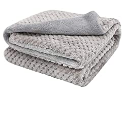 Comfy gray dog blanket made of faux fleece