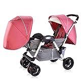 La poussette jumelle de bébé peut s'asseoir et se plier le chariot de bébé face...