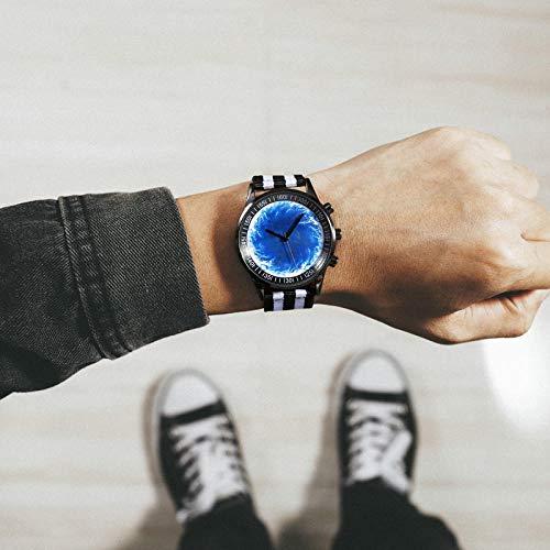 Powzz - Reloj de pulsera para hombre y mujer, diseño de cielo estrellado