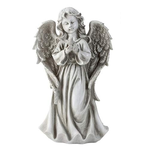 Onbekend engel staat met vogel in de hand. Hoogte 32 cm