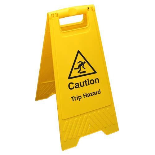 Señal de advertencia de seguridad en el suelo amarillo, texto en inglés'VSafety Caution Trip Hazard'