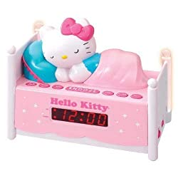 Officially Licensed Hello Kitty KT2052 Alarm Clock Radio with Bed Post NIGHT LIGHTS! Wake to Radio or Alarm ~ Large, Easy to Locate Snooze Button ~ Two Bedposts Light Up for Night Light (On/Off Switch) ~ Built in cord ~ Battery Backup ~ This pink alarm