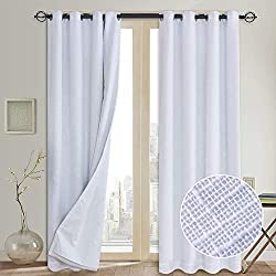 crisp white blackout curtain set on Amazon.