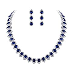 ♥Material: Made of crafted environmental friendly Cubic Zirconia, this bridal jewelry sets shines with grace and beauty. And the metal surface is of high polished finish. ♥Main Color: Sapphire Color; Necklace Size: 17.5 inch L x 0.5 inch W; Earrings ...