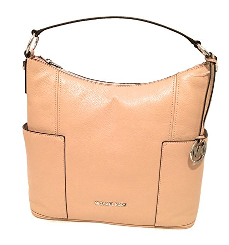 Imported Shoulder Strap Includes removable adjustable cross body Inside is lined in MK Signature Fabric.Center Zip Pocket separates 2 large sections Zip wall pocket and 3 slip pockets total. Michael Kors Leather Patch. 2 Outside Side deep pockets and...