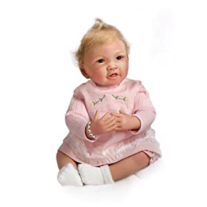 An adorable 'picture-perfect'; collectable lifelike baby doll, originally created by artist Waltraud Hanl and reborn by another accomplished artist, exclusively for the Ashton-Drake Galleries She wears a FREE alphabet-bead bracelet that you personali...
