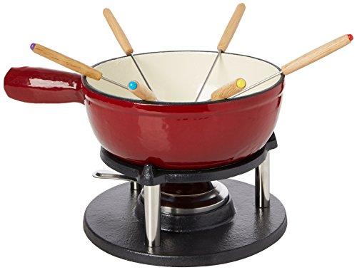 Diametro: 20 cm Contenuto della confezione : 4 pezzi Per 6 persone Ghisa smaltata Contenuto della confezione: 1 fornelletto, 1 bruciatore per pasta (pasta non inclusa), 1 pentola per fonduta in ghisa smaltata in rosso sfumato, 6 forchette per fonduta...