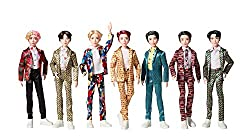 """The fashions on these 11-inch dolls are inspired by the unforgettable custom-designed suits that the BTS artists wear in the """"Idol"""" music video! Dolls are carefully crafted to match each artist's style, including their rooted hair styles. They're ver..."""