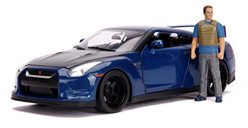 Jada Toys Fast & Furious Brian 's Nissan Skyline GT-R R35 - Luz de Coche Tuning Escala 1:18 con alerón, Puertas abatibles, capó y Maletero, Incluye Figura Brian O'Conner, Color Azul