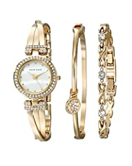 24 millimeter round gold-tone case with Swarovski crystal accents; Mineral crystal lens Mother-of-pearl dial; Gold-tone bangle bracelet with adjustable end links; Jewelry clasp closure and extender link Japanese quartz movement with analog display Wa...