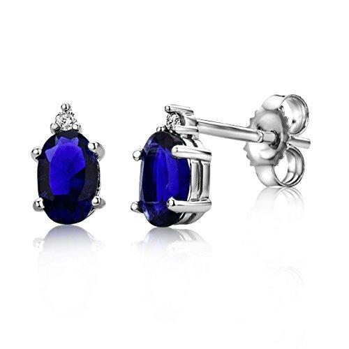 Miore oorbellen uit 9 karaat 375/1000 witgoud met ovalen edelstenen en briljant geslepen diamantjes.