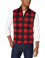 This midweight fleece vest with high collar, full-zip front, and side seam pockets works as a finishing touch to a cool-weather look or a comfy base layer when it's time to bundle up Features zippered pockets, elasticized arm openings and a straight ...