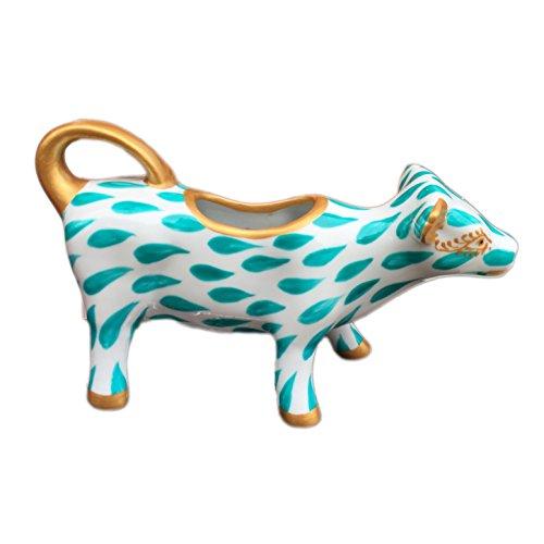 Lattiera in porcellana a forma di mucca, dipinta a mano, disegno originale 'Turchese Spruzzi'. Lussuoso cofanetto regalo rosa e nero.