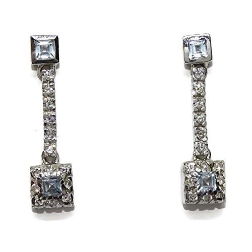 Pendientes de 0.45cts de diamantes y topacio azul en oro blanco de 18Kts. Never say never