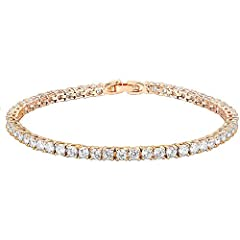 Tennis bracelet featuring round 3mm AAA+ cubic zirconia stones in four-prong basket settings. Measures 7.5 inches in Length Cubic Zirconia (Swarovski Element crystal) set in Lead-free, Eco-friend and hypoallergenic setting. This stunning bracelet is ...