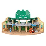 Thomas & Friends Wood Tidmouth Sheds playset includes Nia toy train and poseable figure Features five bays with doors that can fit five Thomas & Friends Wood toy trains, plus two sides and two levels with multiple areas for train and figure play Spin...