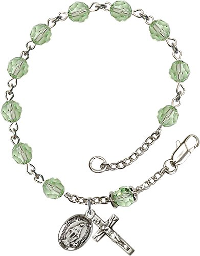 Sterling Silver Rosary Bracelet features 6mm Chrysolite Swarovski, Capped Our Father beads. The Crucifix measures 5/8 x 1/4.