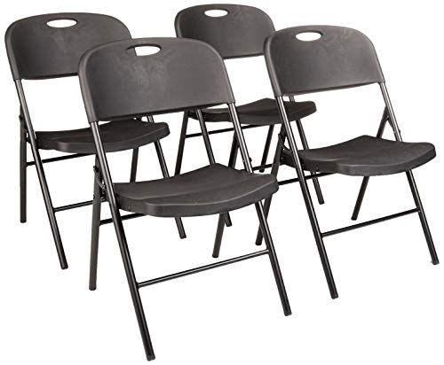Amazon Basics - Silla de plástico plegable, capacidad de 157,5 kg, negro, set de 4