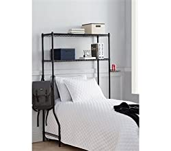 black metal over-the-bed shelving unit over bed with white blanket