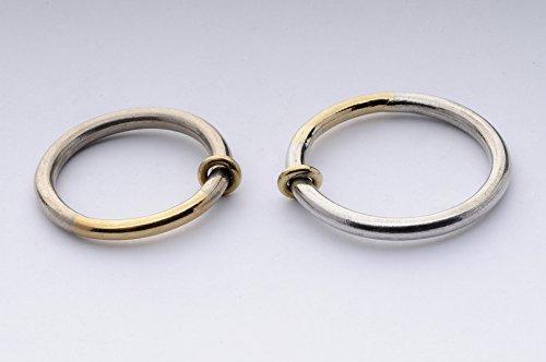 Alianzas de boda de plata y oro brillante