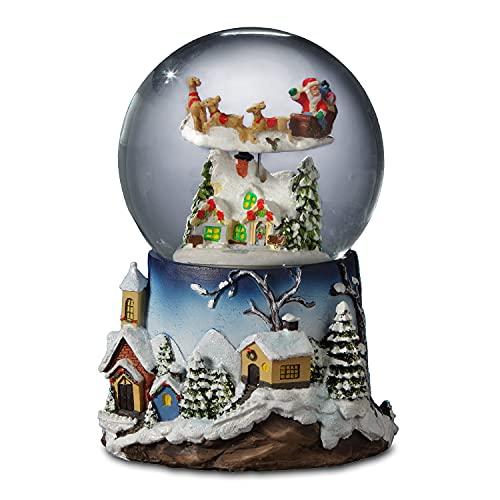 The San Francisco Music Box Company Santa Flying Over Village Snow Globe