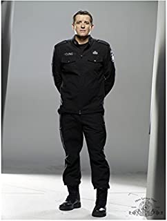 SGU Stargate Universe 8 inch x10 inch Photo Louis Ferreira Black Uniform Hands Behind Back Light Grey Background kn