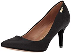 Add a classic silhouette to your wardrobe with the  Calvin Klein® Kylie pump. Faux-leather upper. Easy slip-on design. Brand metal accent at heel. Soft man-made lining. Lightly padded footbed. Wrapped heel. Synthetic outsole. Imported. Measurements: ...