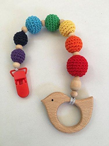 Juguete de dentición de madera Arcoiris hecho a mano. Un regalo original y práctico para el bebé.