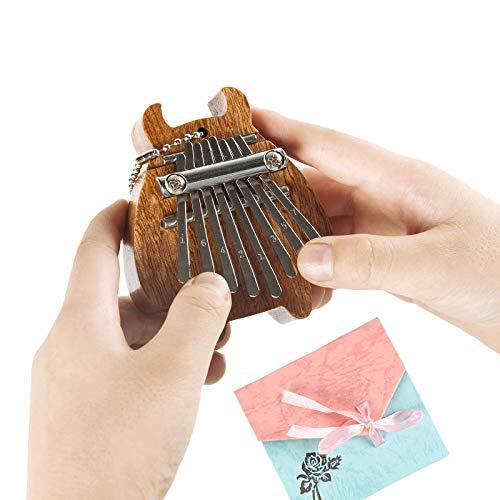 RIMLUFE cute mini kalimba tiny calimba mbira hand harp musical instruments marimba small portable finger thumb piano accessories for kids beginners piano instruments adults 8 key calming gifts
