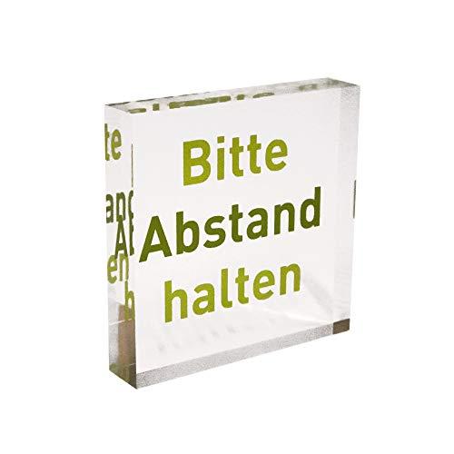 """Transparenter Acrylblock als Infoständer/Hinweisaufsteller mit grünem Aufdruck """"Bitte Abstand halten"""" aus PLEXIGLAS®"""