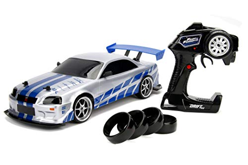 Jada Toys Fast & Furious RC Nissan Skyline GTR, R34, Driftfunktion, RC Auto, Ferngesteuertes Auto mit Funkfernsteuerung, Allradantrieb, 4 Ersatzreifen, USB Ladefunktion, Maßstab 1:10, blau/Silber