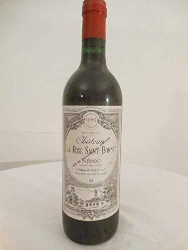 médoc château la rose saint-bonnet rouge 1985 - bordeaux france: une bouteille de vin.