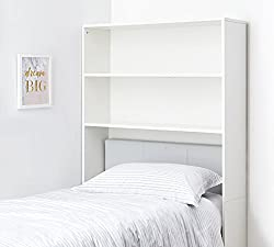 white over-the-bed shelving unit over bed with white blanket